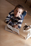 Boy reeding book Stock Images