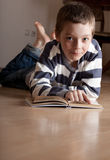 Boy reeding book Royalty Free Stock Image