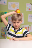 Boy refuitng healthy food. Picture of pouty boy refuting healthy food Royalty Free Stock Photography