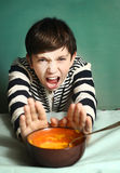 Boy refuse to eat pumpkin cream soup Royalty Free Stock Images