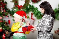 Boy refusing Christmas gift box Royalty Free Stock Photo