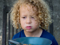 Boy refusing to eat Stock Photo