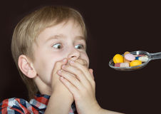 Boy refusing to take medicine Stock Image