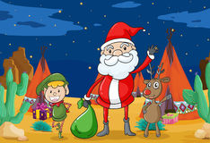 A boy, a reindeer and santaclause Stock Images