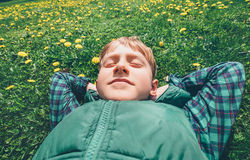Boy relax on green lawn Stock Photos