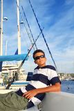 Boy relaxed teenager on boat in vacation Royalty Free Stock Photography