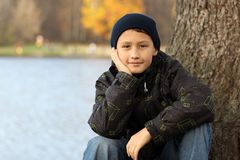 Boy relaxing in autumn Stock Image