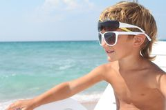 Boy relaxing on beach Royalty Free Stock Images