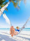 Boy relaxing on a beach. Stock Photo