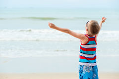 The boy is relaxing on the beach enjoying a vacation. On the sea Stock Photo
