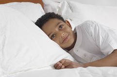 Boy Relaxing In Bed Royalty Free Stock Images