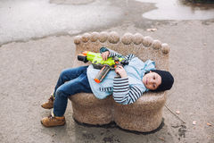Boy relaxing on bench in park Stock Photo