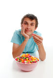 Boy relaxing with bowl popcorn Royalty Free Stock Photos