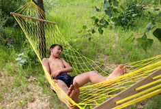 Boy relaxing in hammock Stock Images