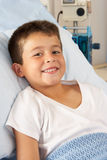 Boy Relaxing In Hospital Bed. Smiling Stock Photos