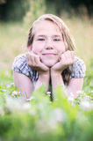 Girl relaxing in meadow Stock Image