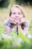 Girl relaxing in meadow Stock Image
