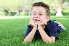 Boy Relaxing in Park Royalty Free Stock Photo
