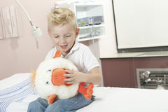 Boy Relaxing in pediatric hospital Stock Image