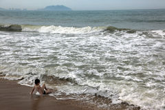 Boy relaxing at sea Royalty Free Stock Photography