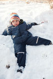 Boy relaxing in snow royalty free stock photos