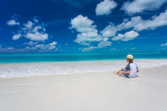 Boy relaxing on the tropical beach Royalty Free Stock Photography