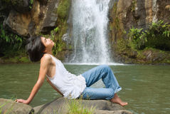 Boy relaxing at waterfall Royalty Free Stock Photo