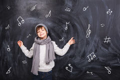 The boy remembers notes Royalty Free Stock Images