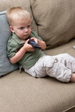 Boy with remote Stock Photography