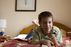 Boy with a remote control Stock Photos