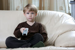 Boy with remote control Stock Image