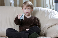Boy with remote control Stock Photography