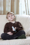 Boy with remote control Royalty Free Stock Photography