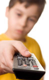 Boy with remote control. In his hand royalty free stock image