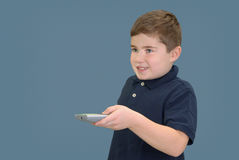 Boy with Remote Control Royalty Free Stock Photo