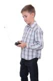 Boy with remote controller Stock Photos