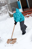 Boy removes snow Stock Photo