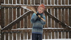 Boy removes snow shovel near the house. Cleaning snow in the winter near the house. stock video