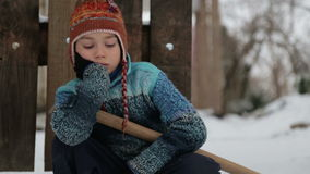 Boy removes snow shovel near the house. Cleaning snow in the winter near the house. stock video footage