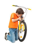 Boy repair bicycle Stock Photography
