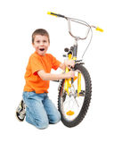 Boy repair bicycle Stock Images