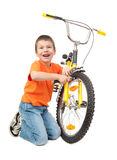 Boy repair bicycle isolated Stock Photo