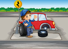 A boy repairing a car at the pedestrian lane Royalty Free Stock Photo
