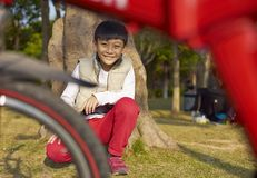Boy rest after riding bike Stock Photography