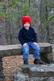 Boy Resting. Boy sitting on bench royalty free stock photos