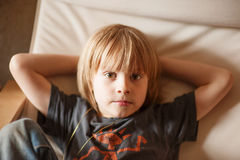 Boy resting in an armchair Royalty Free Stock Images