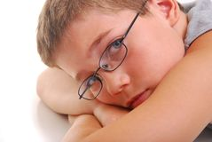 Boy resting on arms Royalty Free Stock Image