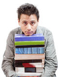 Boy Resting Chin in Stack on Books Stock Photography