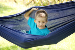 Boy resting in a hammock Stock Photos