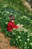 Boy resting sitting on the grass during a country walk royalty free stock photos